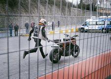 Free Man Holding Orange And Black Sports Bike On Asphalt Road Stock Images - 111364604