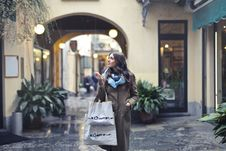 Free Woman In Brown Full-zip Long-sleeved Coat With Tote Bags Stock Photography - 111364712
