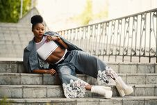Free Woman Wearing White Sports Bra And Gray Pants Laying On Stairway Stock Images - 111364724