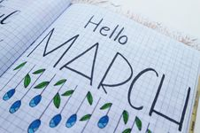 Free Hello March Printed Paper On White Surface Royalty Free Stock Image - 111457296