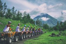 Free Line Of Men Riding On All Terrain Vehicles Holding Out Hand In A Fist Royalty Free Stock Images - 111457319