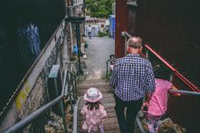 Free Man And Two Girls Walking Down On Stairs Stock Image - 111457341