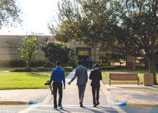 Free Three Man Walking On Street Wearing Suit Jackets Royalty Free Stock Image - 111457396