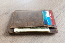 Free Brown Leather Wallet And Us Dollar Banknote Stock Images - 111457404