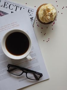Free White Ceramic Cup With Coffee On Top Of Opened Book And Near Eyeglasses Stock Image - 111457431