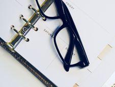 Free Black Framed Wayfarer Style Eyeglasses On White Surface Royalty Free Stock Photography - 111457437