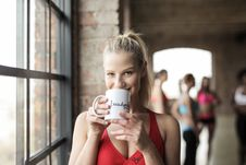 Free Woman In Red Scoop-neck Tank Top Holding White Mug Stock Images - 111457444