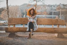 Free Woman Wearing Floral Cardigan Sit On Bench Stock Photo - 111457490