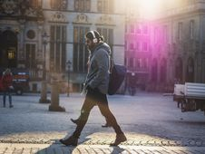 Free Man In Gray Hooded Jacket Walking On Gray Bricks Pavement Stock Photography - 111545372
