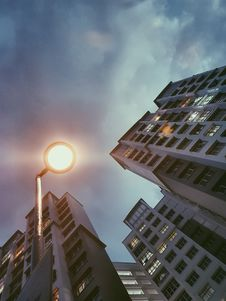 Free Low Angle Photography Of Lamp Post Beside Building Under Cloudy Sky Royalty Free Stock Image - 111545376