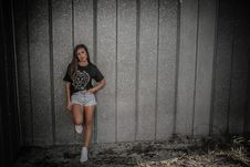 Free Woman Wearing Black Shirt And Daisy Dukes Leaning On Wall Stock Photography - 111545402