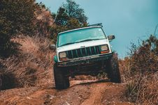 Free White Jeep Suv Cruising Down The Road Stock Photos - 111545473