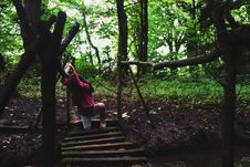 Free Girl In Pink Jacket On Wooden Bridge In The Forest Royalty Free Stock Photography - 111545587