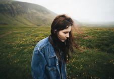 Free Woman Wearing Blue Denim Jacket Walking On The Green Grass Field Stock Photos - 111545673
