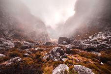 Free Gray Stones In Grassy Mountains During Foggy Day Stock Images - 111545694