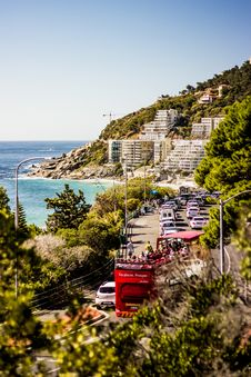Free Cars On Road Near Blue Sea And Green Covered Mountains Royalty Free Stock Image - 111545726