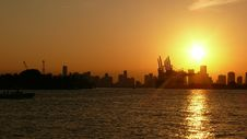 Free Silhouette Of Buildings Near Body Of Water Under Golden Hour Stock Photos - 111615133