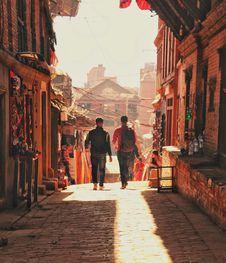 Free Two Man Walking Beside Brick Houses Stock Photo - 111615140