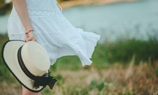 Free Woman In White Dress Holding White And Black Hat At Daytime Stock Photography - 111615142