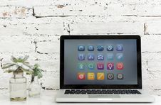 Free Turned On Macbook Pro Beside Succulents Stock Image - 111615171