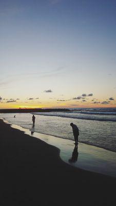 Free Two People At Beach During Sunrise Stock Photography - 111615182