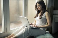 Free Woman Wearing Tank Top Sitting By The Window Royalty Free Stock Photos - 111615328