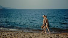 Free Couple Walking On The Beach At Daytime Royalty Free Stock Images - 111615329