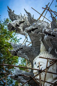 Free White Buddha With Dragon Concrete Statue E Stock Photo - 111615370