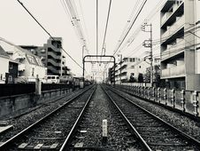Free Grayscale Photography Of Train Rail Between Buildings Stock Image - 111615371