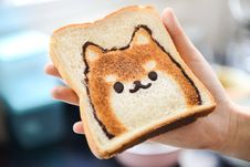 Free Slice Of Loaf Bread With Dog Face Stock Photos - 111823693
