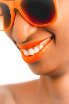 Free Woman Wearing Orange Frame Sunglasses And Orange Lipstick Stock Photo - 111823870