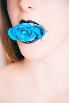 Free Woman With Black Lipstick Biting Blue Rose Stock Photo - 111823930