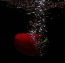 Free Red Fruit In Waterfall Stock Image - 1128301