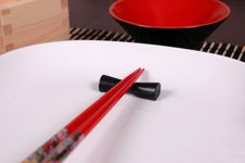 Free Chopsticks On White Plate Royalty Free Stock Photo - 1128805