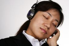 Free Asian Businesswoman Listening Royalty Free Stock Image - 1129916