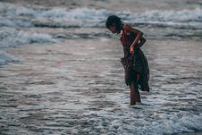 Free Girl Standing On Seashore Royalty Free Stock Image - 112089756