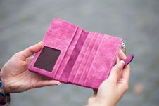 Free Person Holding Pink Suede Long Waller Stock Image - 112089761