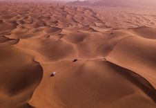 Free Two Vehicles On Desert Dunes Stock Photo - 112089790