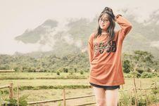 Free Woman Wearing Orange Long-sleeved Shirt Stock Photos - 112089793