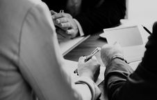Free Grayscale Photo Of Three Person Sitting Near Table Royalty Free Stock Photos - 112089798