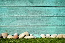 Free Pile Of White And Blue Stones In Front Blue Painted Wall Stock Image - 112089801