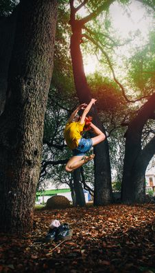 Free Person In Yellow Shirt And Blue Denim Shorts Doing Ballet Stance On Woods Royalty Free Stock Image - 112089806