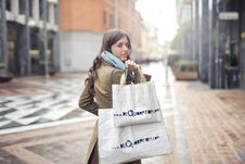 Free Woman In Brown Coat Carrying Two White Tote Bags Stock Photo - 112089840