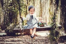 Free Girl In Black And White Overall Skirt Holding Basket With Petaled Flowers Royalty Free Stock Images - 112089979