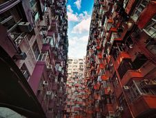 Free Purple And Red Concrete Buildings And Cloudy Sky Stock Images - 112090054