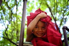 Free Boy Holding Red Textile Covering His Head Royalty Free Stock Photography - 112090077
