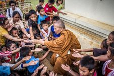 Free Monk Surrounded By Children Stock Image - 112090131