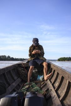 Free Man Wearing Black Cap Sitting Inside A Boat Royalty Free Stock Photography - 112184487