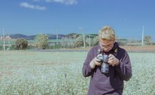 Free Man Holding Black Dslr Camera Under Blue Sky Royalty Free Stock Photography - 112184557