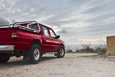 Free Red Pickup Truck Parked Near Wall Royalty Free Stock Images - 112184649